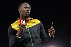 Jamaica's Bolt holds his gold medal after Jamaica won the men's 4x100m relay final at the 2014 Commonwealth Games in Glasgow