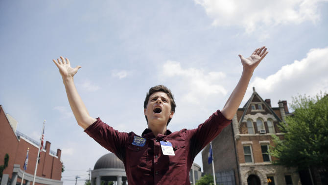 FILE - Christian Olivera, of Newark, N.J., shouts toward the Statehouse in Trenton, N.J. on Thursday, June 27, 2013 as he and other advocates for gay marriage in New Jersey gather, saying they'll press their case in the legislature and the courts after the U.S. Supreme Court ruling that invalidates parts of the federal Defense of Marriage Act. Gov. Chris Christie said he would again veto a same-sex marriage bill if it reaches his desk, and that Wednesday's U.S. Supreme Court ruling striking down a ban on federal benefits for same-sex married couples will have no effect on New Jersey, one of a handful of states that allows civil unions. (AP Photo/Mel Evans)