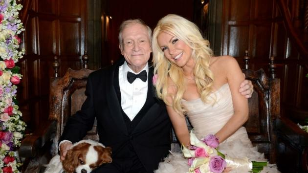 Hugh Hefner and Crystal Harris pose for photos following their wedding at the Playboy Mansion on December 31, 2012 -- Elayne Lodge