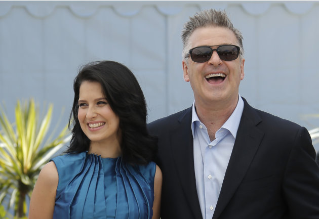 Actor Alec Baldwin, right, and his wife Hilaria Thomas pose for photographers during a photo call for the film Seduced and Abandoned at the 66th international film festival, in Cannes, southern France