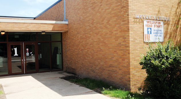 In this June 8, 2012, McVay Elementary school in Williston, N.D., is shown. To keep pace with the expected influx of students, school officials are hiring 52 new teachers, adding dozens of modular classrooms and reopening McVay Elementary that shuttered a dozen years ago due to declining enrollment after the region's first oil boom went bust. (AP Photo/Williston Herald, Jackson Bolstad)