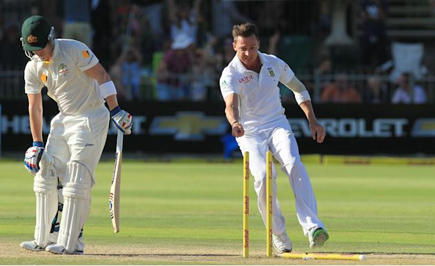 South Africa's bowler Dale Steyn, right, points at fallen stumps after after bowling Australia's batsman Brad Haddin, left, for 1 run on the fourth day of their 2nd cricket test match at St Ge