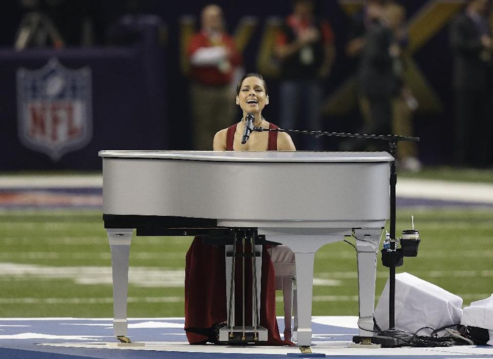 Alicia Keys sings the national anthem before the NFL Super Bowl XLVII football game between the San Francisco 49ers and the Baltimore Ravens, Sunday, Feb. 3, 2013, in New Orleans. (AP Photo/Gene Puskar)