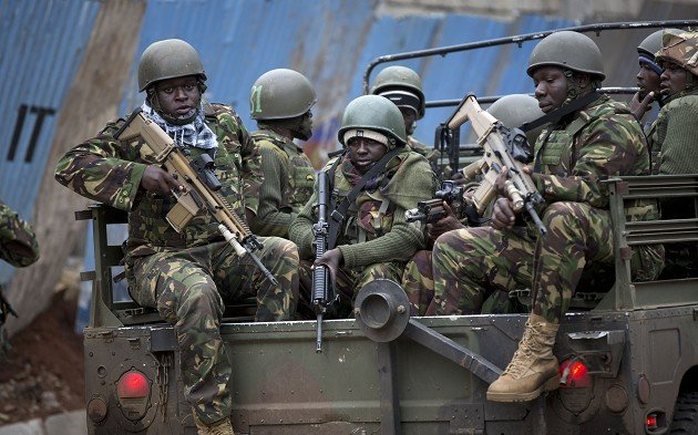 Trucks of soldiers from the Kenya Defense Forces arrive outside the Westgate Mall in Nairobi, Kenya (AP)