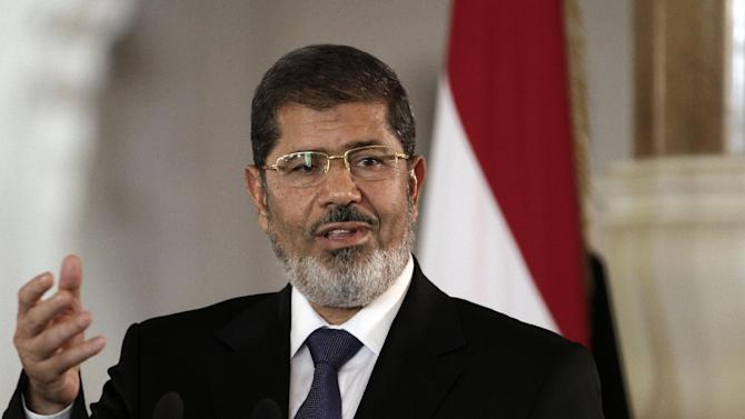 In this July 13, 2012 file photo, Egyptian President Mohammed Morsi speaks to reporters at the Presidential palace in Cairo. President Barack Obama begins his second term straining to maintain a good relationship with Egypt, an important U.S. ally whose president is a conservative Islamist walking a fine line between acting as a moderate peace broker and keeping his Muslim Brotherhood party happy with anti-American rhetoric. The White House last summer had hoped to smooth over some of the traditional tensions between Washington and the Brotherhood, a party rooted in opposition to Israel and the U.S., when Egypt overthrew dictator Hosni Mubarak and picked Morsi as its first democratically-elected leader. (AP Photo/Maya Alleruzzo, File)