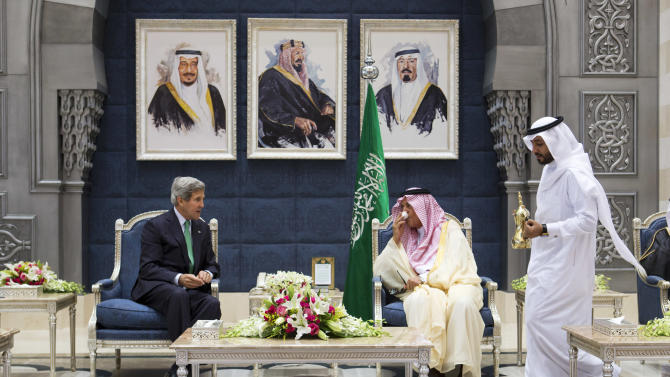 U.S. Secretary of State John Kerry, left, attends a coffee ceremony with Saudi Foreign Minister Prince Saud al-Faisal as a welcome upon Kerry's arrival in Jeddah, Saudi Arabia, Tuesday, June 25, 2013. Kerry is on a day visit before continuing on to Kuwait, as he returns to his Middle East tour after a stop in India. (AP Photo/Jacquelyn Martin, Pool)