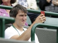 Washington Capitals hockey player Alexander Ovechkin watches Maria Kirilenko of Russia play Agnieszka Radwanska of Poland during a quarterfinals match at the All England Lawn Tennis Championships at Wimbledon, England, Tuesday, July 3, 2012. (AP Photo/Kirsty Wigglesworth)