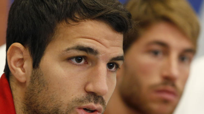 Spain's Cesc Fabregas, left, and Sergio Ramos attend a press conference in Kiev, Ukraine, Friday, June 29, 2012. Spain  reached the final of Euro 2012 soccer championship. (AP Photo/Efrem Lukatsky)
