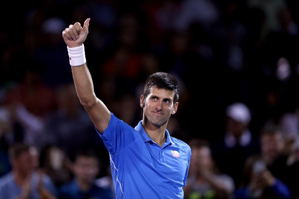 Djokovic overcomes wobble to win Miami opener
