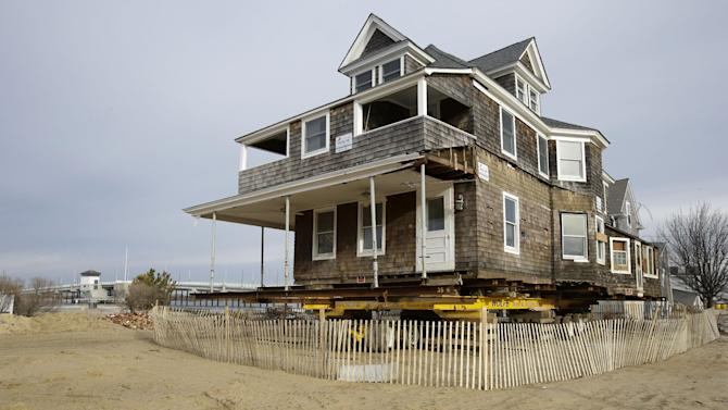 A damaged bayside home rests on a wheeled frame waiting to be raised in Mantoloking, N.J., Friday, Feb. 22, 2013. One of the hardest-hit Jersey shore communities, Mantoloking, will allow its residents to begin moving back home Friday. It is the last shore town to do so. It's not a mad rush. The winter population of the barrier island community totals only about 100 and many homes are not yet livable. And some people have no home to come back to. Sixty or so houses disappeared completely and hundreds more were so badly damaged they'll probably need to be demolished. (AP Photo/Mel Evans)