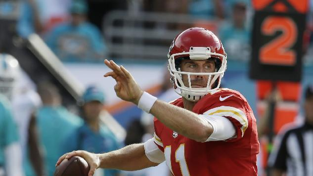 Kansas City Chiefs quarterback Alex Smith (11) looks to pass during the first half of an NFL football game against the Miami Dolphins, Sunday, Sept. 21, 2014, in Miami Gardens, Fla