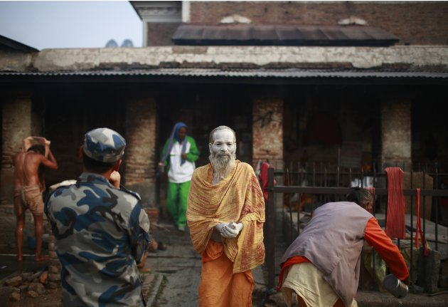 A sadhu walks out from his ashram at Pashupatinath Temple in Kathmandu