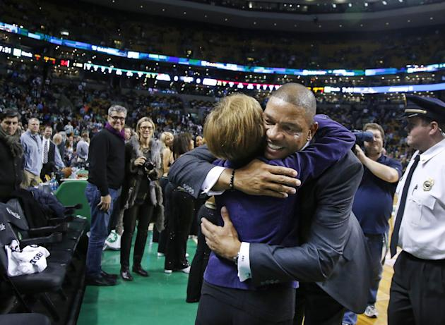 Doc Rivers, former head coach of the Boston Celtics and current head coach of the Los Angeles Clippers, hugs a well-wisher as he enters the TD Garden floor for his first time back, before an NBA baske