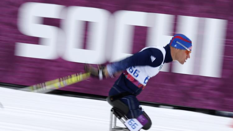 Chossen of the U.S. skis during the men's 15 km biathlon sitting at the 2014 Sochi Paralympic Winter Games in Rosa Khutor