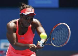 Sloane Stephens of the U.S. hits a return to Elina Svitolina of Ukraine during their women's singles match at the Australian Open 2014 tennis tournament in Melbourne