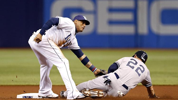 Tampa Bay Rays shortstop Yunel Escobar tags out New York Yankees' Jacoby Ellsbury on an attempted steal of second base during the first inning of a baseball game Saturday, April 19, 2014, in St. Petersburg, Fla. (AP Photo/Mike Carlson)