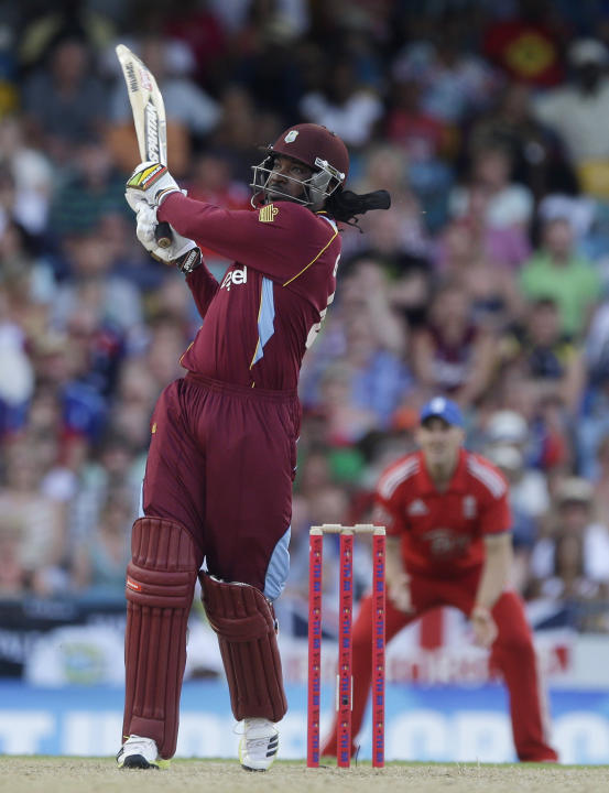 West Indies' Chris Gayle plays a shot during the second T20 International cricket match against England at the Kensington Oval in Bridgetown, Barbados, Tuesday, March 11, 2014. (AP Photo/Ricardo M