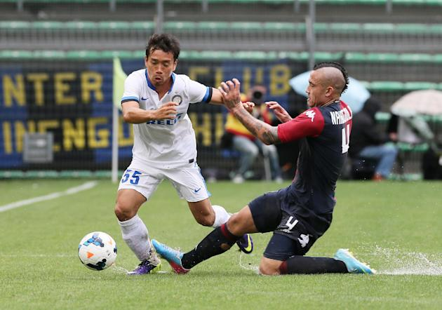 Inter Milan Japanese defender Yuto Nagatomo, left, is takcled by Cagliari's Radja Nainggolan, during the Serie A soccer match between Cagliari and Inter, at the Nereo Rocco Stadium in Trieste, Italy,