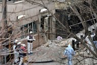Turkish police and forensic experts inspect at the site of a blast outside the US embassy in Ankara, on February 1, 2013. The United States has sent an FBI team to join the Turkish investigation into a deadly suicide bombing on the US embassy in Ankara last week