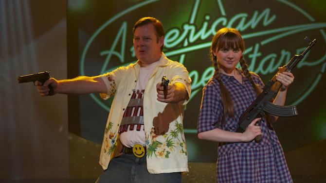 """In this film image released by Magnolia Pictures, Joel Murray, left, and Tara Lynne Barr are shown in a scene from """"God Bless America."""" (AP Photo/Magnolia Pictures)"""