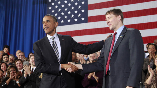 Stirring up a fight, Obama names consumer watchdog
