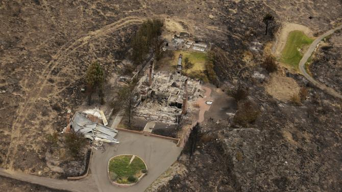 This aerial photo shows structures which were destroyed by wildfires near Pateros, Wash. on Thursday, July 24, 2014. Fire spokesman Pete Buist says the biggest wildfire in the state's history remains at 52 percent contained on Thursday. However, the weather forecast calls for hot and dry conditions to return over the next few days. (AP Photo)
