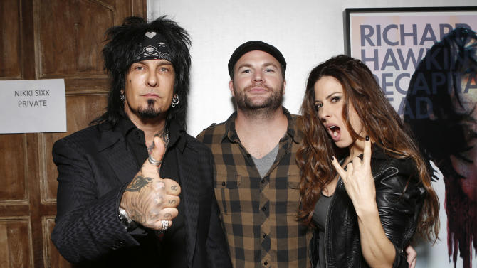 IMAGE DISTRIBUTED FOR HOUSE OF ROCK - 98.7's Nikki Sixx, Darren Rose and Kerri Kasem attend the 98.7 Saves Christmas Party at The House of Rock on Wednesday, Dec. 5, 2012, in Los Angeles, Calif. (Photo by Todd Williamson/Invision for House of Rock/AP)