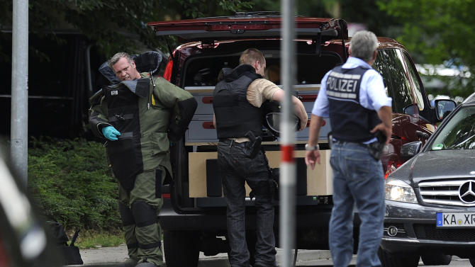 Police arrive at the area where a gunman took hostages in Karlsruhe, Germany, Wednesday July 4, 2012. A gunman in southern Germany took hostages and fired shots, possibly killing one person, when court bailiffs sought to remove him from his apartment Wednesday morning in a dispute over rent, police said. (AP Photo/dapd /Michael Latz)