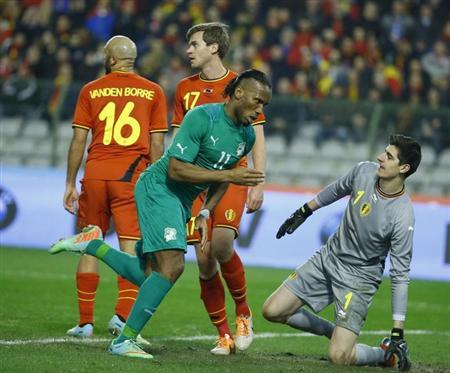 Ivory Coast's Drogba celebrates scoring a goal past Belgium's goalkeeper Courtois during their international friendly soccer match at King Baudouin Stadium in Brussels