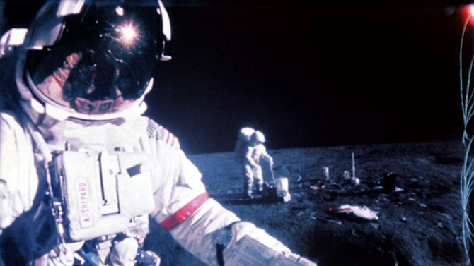A picture taken during the Apollo 14 mission in February 1971 shows US astronauts Alan Shepard (L) and Edgar Mitchell (R) on the moon