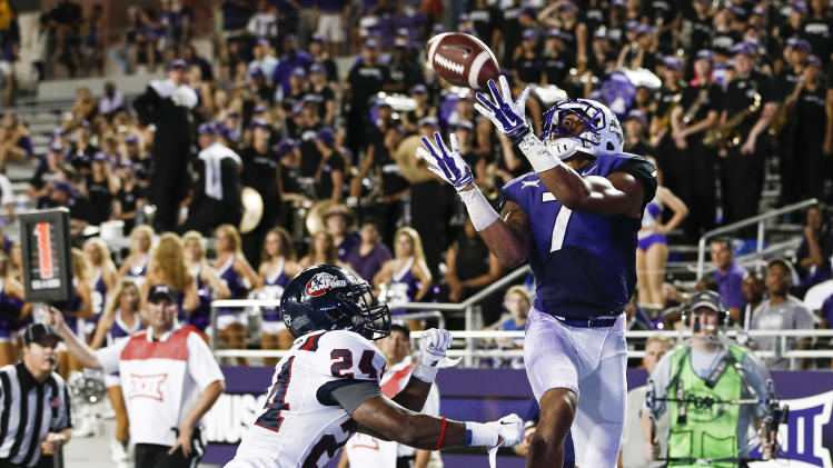 TCU wide receiver Kolby Listenbee (7) catches a touchdown pass in front of Samford safety Trey Wesley (24) in the second half of an NCAA college football game in Fort Worth, Texas, Saturday, Aug. 30, 2014. TCU won 48-14. (AP Photo/Jim Cowsert)