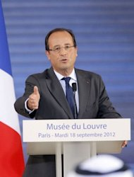 France's President Francois Hollande delivers a speech during the official opening ceremony of the new Department of Islamic Arts at the Louvre on September 18 in Paris. France is home to at least four million Muslims and leaders of the community say incidents of Islamophobia are on the rise against a background of confrontation with the authorities and rising suspicion of Muslims