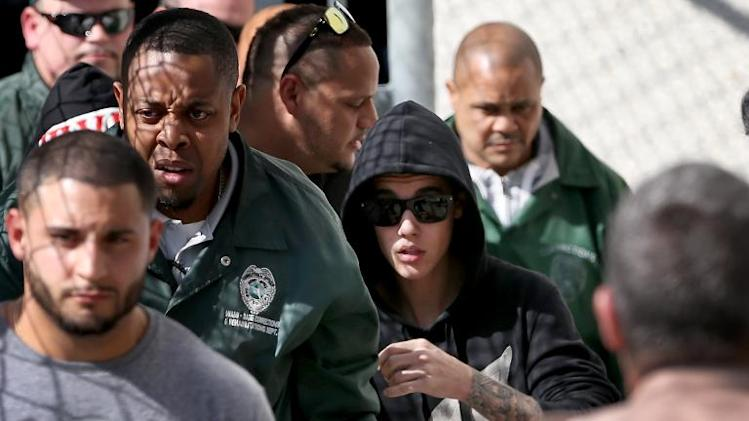 Justin Bieber (R) exits from the Turner Guilford Knight Correctional Center on January 23, 2014 in Miami, Florida