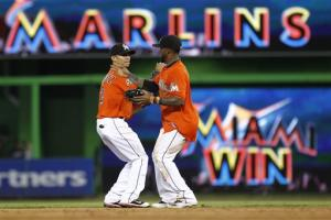 Reyes drives in 3 runs as Marlins top Brewers 7-3