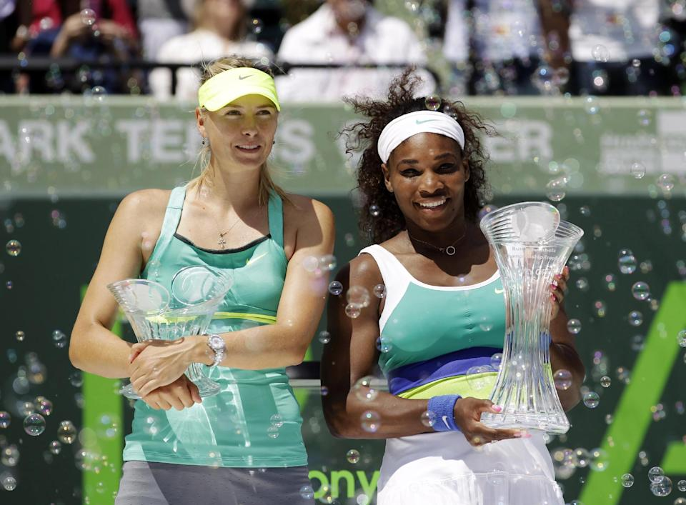 Serena Williams, right, and Maria Sharapova, of Russia, pose with their trophies after the final match at the Sony Open tennis tournament, in Key Biscayne, Fla., Saturday, March 30, 2013. Williams won 4-6, 6-3, 6-0. (AP Photo/Alan Diaz)