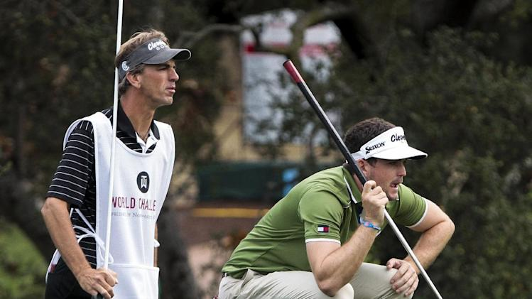 Keegan Bradley, right, lines up a putt as his caddie watches on the 18th green during the second round of the World Challenge golf tournament at Sherwood Country Club in Thousand Oaks, Calif., Friday, Nov. 30, 2012. (AP Photo/Bret Hartman)