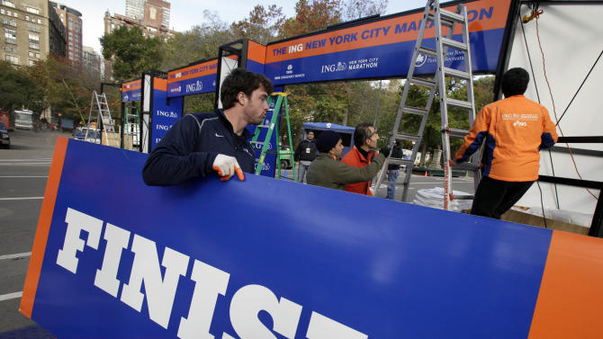 Workers assemble the finish line for the New York City Marathon in New York's Central Park,  Thursday, Nov. 1, 2012.  The 43rd New York City Marathon is on Sunday, with many logistical questions to be answered. (AP Photo/Richard Drew)Workers assemble the finish line for the New York City Marathon in New York's Central Park, Thursday, Nov. 1, 2012.  The New York City Marathon is on Sunday, with many logistical questions to be answered. (AP Photo/Richard Drew)