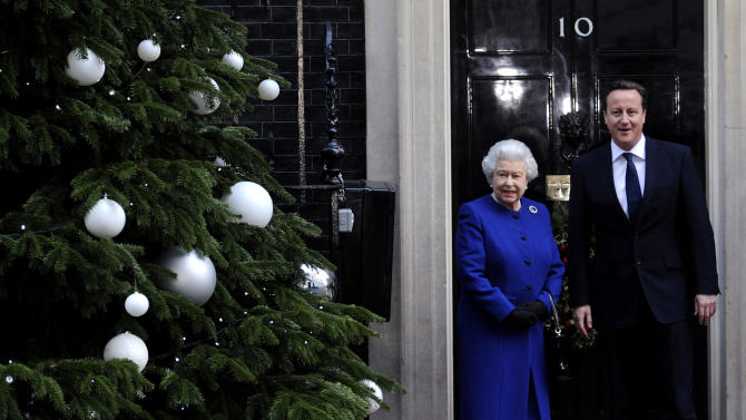 Britain's Queen Elizabeth II, left, is met by British Prime Minister David Cameron prior to attending a Cabinet meeting at 10 Downing Street, London, Tuesday, Dec. 18, 2012. Queen Elizabeth II sat in on a Cabinet meeting for the first time on Tuesday, taking a seat between British Prime Minister David Cameron and Foreign Secretary William Hague to observe the weekly discussion of government business. (AP Photo/PA, Stefan Rousseau) UNITED KINGDOM OUT, NO SALES, NO ARCHIVE