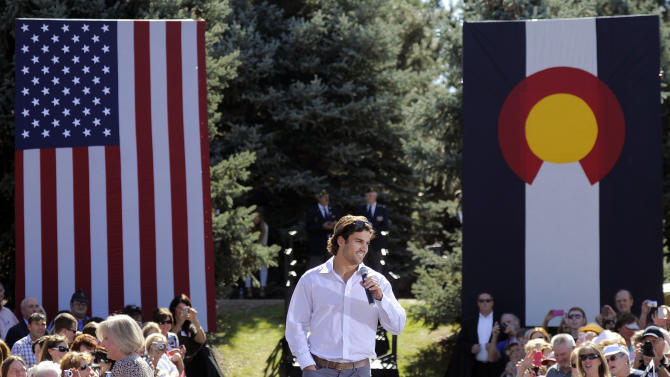 Eric Decker, wide receiver for the Denver Broncos speaks in support of Mitt Romney at a campaign event at Hudson Gardens and Event Center in Littleton, Colo., on Tuesday, Oct. 2, 2012. Ann Romney, wife of Republican presidential candidate Romney, was the featured speaker at the event. (AP Photo/Chris Schneider)