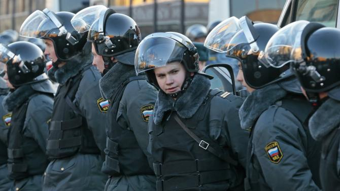 Police officers guard during an unauthorized rally in Lubyanka Square in Moscow, Saturday, Dec. 15, 2012. Thousands of opposition supporters have gathered in central Moscow for an unauthorized rally and several prominent opposition figures have been detained. (AP Photo/Mikhail Metzel)
