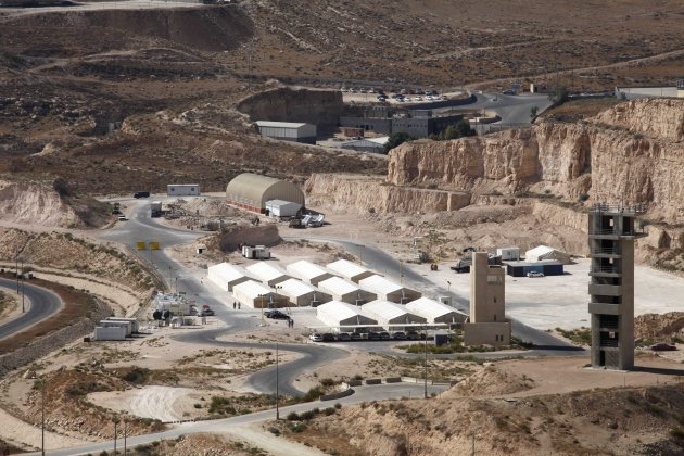 A general view of hangars at a desert military training facility where U.S. forces _ and a handful of British allies _ are training Jordanian commandos in Russeifeh, Jordan, Thursday, Oct. 11, 2012. Jordanian officials tell The Associated Press that the military planners are here to help them develop a blueprint to defend Jordan and its population in case of a chemical attack from neighboring Syria.(AP Photo/Mohammad Hannon)