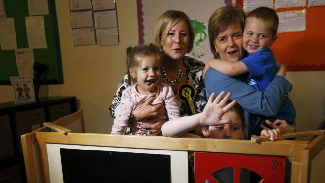 Nicola Sturgeon leader of the Scottish National Party, poses for pictures in play house during an election visit to a nursery in Livingston