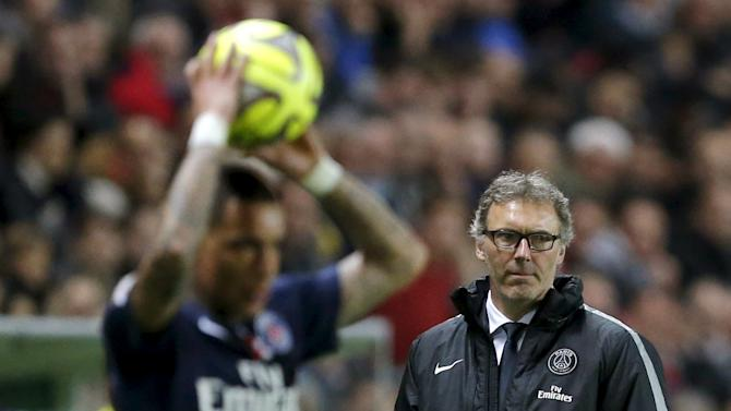 Paris St Germain coach Blanc looks on during their French Ligue 1 soccer match against FC Nantes at the Beaujoire stadium in Nantes