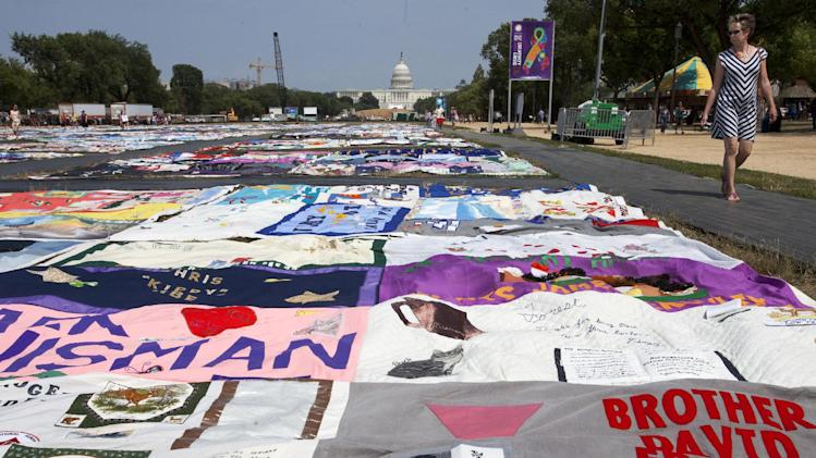FILE - In this July 5, 2012 file photo, people visit the AIDS Memorial Quilt on display as part of the Smithsonian Folklife Festival on the National Mall in Washington, on Thursday, July 5, 2012.  (AP Photo/Jacquelyn Martin)