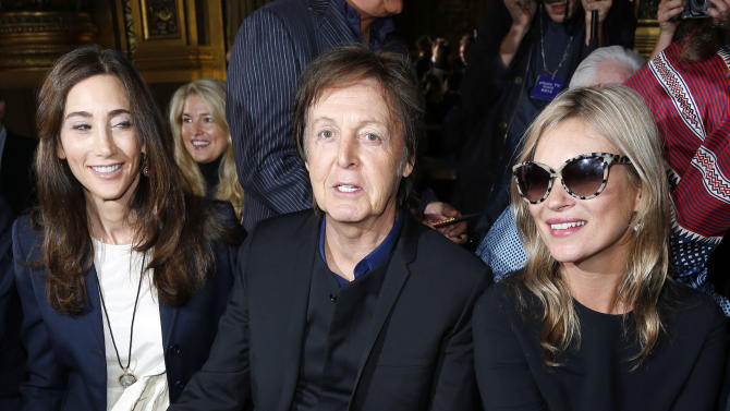 Sir Paul McCartney, his wife Nancy Shevell and model Kate Moss, right, take their sets in the front row for British fashion designer Stella McCartney's ready to wear Spring-Summer 2013 collection, presented in Paris, Monday, Oct.1, 2012. (AP Photo)