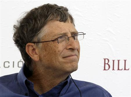 Microsoft founder and philanthropist Bill Gates listens during a news conference in Texcoco