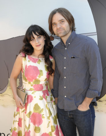 "FILE - In this July 10, 2011 file photo, actress Zooey Deschanel, left, and her husband, musician Ben Gibbard arrive at the premiere of the animated feature film ""Winnie the Pooh"" at The Walt Disney Studios in Burbank, Calif. Deschanel filed for divorce from Death Cab for Cutie lead singer Ben Gibbard on Dec. 27 in Los Angeles. (AP Photo/Dan Steinberg, file)"