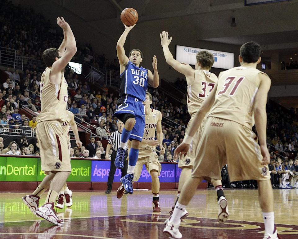 Duke's Seth Curry (30) shoots over the defense of all five Boston College players during the first half of an NCAA college basketball game in Boston, Sunday, Feb. 10, 2013. (AP Photo/Mary Schwalm)
