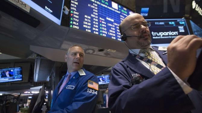 Specialist trader Geoffrey Friedman gives a price just after the opening bell on the floor of the New York Stock Exchange