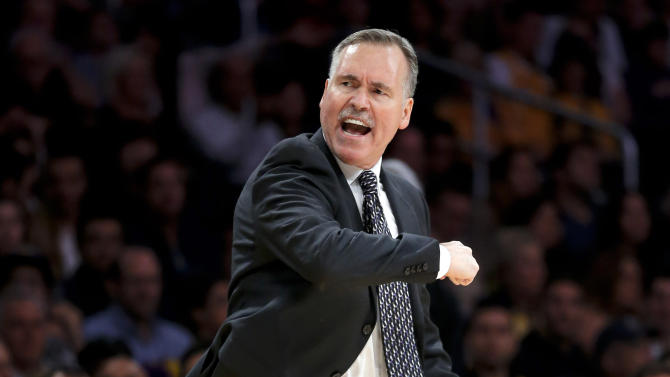 Los Angeles Lakers head coach Mike D'Antoni gestures as he directs his team in the first half of an NBA basketball game against the Brooklyn Nets in Los Angeles, Tuesday, Nov. 20, 2012. (AP Photo/Jae C. Hong)
